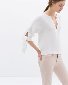 V-NECK TOP WITH KNOTTED SLEEVE by ZARA