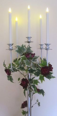 CANDELABRA WITH IVY GARLAND & ARTIFICIAL RED ROSES £25.00