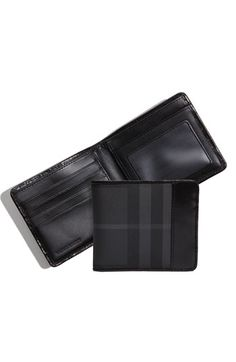 Burberry Wallet, my girlfriend give it to me and it is so nice. An excelent gift.