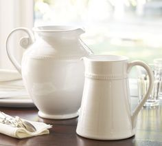 Gabriella Pitchers The fine detail of 18th-century European ceramics is echoed in our stoneware pitcher. It's embellished with an elegantly coiled handle and hand-applied ridging detail, and its new burnished-gold finish brightens the table with autumnal hues.{affiliate link}