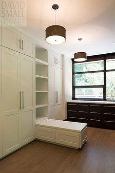 Dark cabinetry by the window accentuates both the view and the simple lines of the lighter cabinetry within.