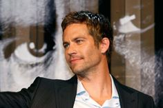 Paul Walker smiles during the premiere of the movie Fast and Furious 4 in Taipei April 15, 2009