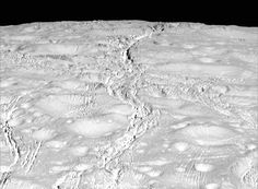 The north pole of Saturn's icy moon Enceladus is seen in an image from NASA's Cassini spacecraft taken October 14, 2015. The moon's north pole lies approximately at the top of this view from Cassini's wide-angle camera. The view was acquired at a distance of approximately 4,000 miles (6,000 kilometers) from Enceladus.