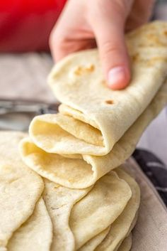 Flour Tortillas From Scratch A hand holding a stack of soft, pliable homemade flour tortillas.A hand holding a stack of soft, pliable homemade flour tortillas. Vegan Recipes, Cooking Recipes, Soft Food Recipes, Recipes Dinner, Catering Recipes, Amish Recipes, Easy Bread Recipes, Cooking Bacon, Catering Ideas