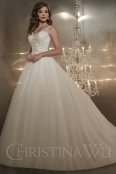 Christina Wu 15561 is a diamond tulle ball #gown with sheer tulle overlay. V-back and V-neck illusion tank on beaded sweetheart bodice. #wedding