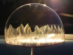 A friend of mine took these pics of a bubble as it was freezing. Blew me away. - Imgur