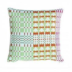 Cushions by Donna Wilson. 100% lambswool and 100% cotton cushions, made in the UK.