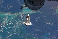 2011, July 10: Atlantis flying over the Bahamas before docking with the space station.  (AP Photo/NASA)  #news #events #shuttle
