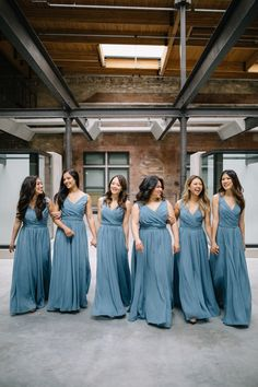 These bridesmaids look flawless in slate blue bridesmaid dresses.   Whims and Joy Photography