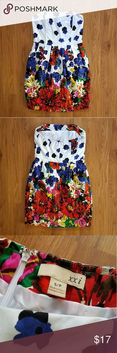 """xxi strapless floral dress 💓 closet going on vaca 4/18 for 4-6 weeks💓 White strapless dress covered in stunning bright colored flowers.  Measurements are 26"""" bust, 28"""" waist, and 27"""" length from top of bust to bottom of hem. Excellent used condition. Forever 21 Dresses Strapless"""