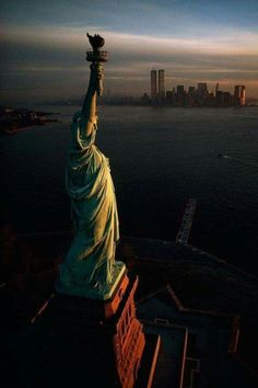 """"""" The Statue of Liberty hails dawn over New York Harbor in 1978 Photograph by David Alan Harvey, National Geographic Creative """" note the twin towers. World Trade Center, Places To Travel, Places To See, Photographie New York, Photo New York, New York Harbor, Empire State Of Mind, Dream City, Jolie Photo"""
