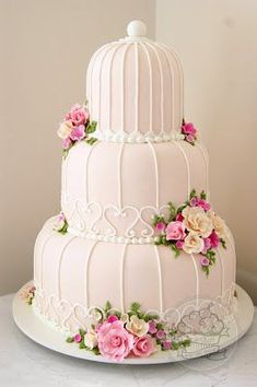 Lara Stolf Arte em Açucar Mais. Beautiful wedding cake reminiscent of a birdcage. With pretty pink and white flowers. Maybe for a bird themed wedding?