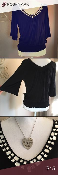 American Rag top Very cute black top by American Rag. Sleeves are slightly belled. Waistband is elastic. Neckline is lined in gems (all intact - see close up.) So flattering. Cute for a night out! American Rag Tops