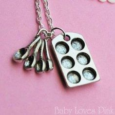 Muffin Pan and Measuring Spoon - Baking Necklace.   I already have a kitchen aid necklace like this.