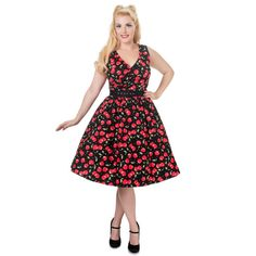 Gorgeous 50s style swing dress made from soft, stretch cotton fabric with a pretty cherry print design.