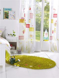 "Imitation grass rug with little flowers ""growing"" on it.   Am I the only one that sees the creepy gnome looking in?"