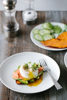 "These Sweet Potato ""Toasts"" come from the creative lady behind Downshiftology - Lisa Bryan. Lisa has topped these toasts with avo, cucumber, almond and poached eggs, but feel free to top with whatever your heart fancies. – I Quit Sugar"