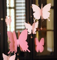 3D paper butterfly mobile, baby nursery, room decoration in shaded pink. $32.00, via Etsy.