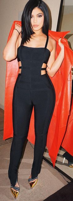 Kylie Jenner Cartier Love bracelet, gold pointy heels - Louboutin , and cut out bandage jumpsuit - herve leger
