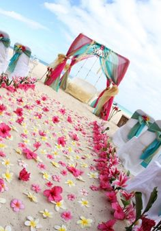 Brighten up your #beachwedding with bold colors and flowers.