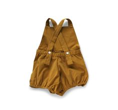 bib front playsuit in a super soft fine wale corduroywith bloomer bottoms. straps cross in back with adjustable buttonholes. 3m, 6m, 12m, 18m, 2/3, 4/5, 6/7100