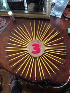 Pencil wreath for 3rd grade classroom door. Pencils glued to cork board