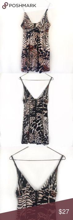 Urban Outfitters Cutout Animal Print Mini Dress Cute and strappy, babydoll style mini dress. Mixed animal print on an off white dress. Ties in the back and cut outs under the bust. Adjustable straps. Size Medium but fits a little small. (121717) Dresses