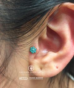 A lovely tragus piercing we had the pleasure of doing for Jocelyn. 14g threaded flower from anatometal, with mint green gems set in implant grade titanium. Thank you, Jocelyn!vaughnbodyartsMonterey, CA