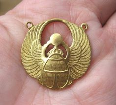 Vintage Brass EGYPTIAN WINGED SCARAB Centerpiece Charm. $2.95, via Etsy.