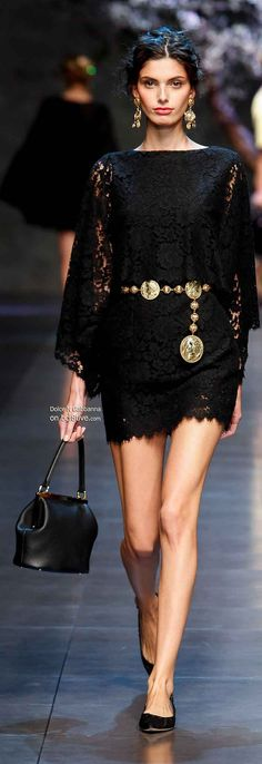 The best little black dress ever! So obsessed with this Dolce & Gabbana long sleeved laced dress.