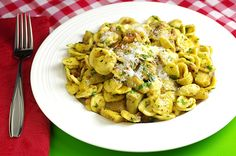 Orecchiette with Artichokes and Bacon  Orecchiette con Carciofi e Pancetta  The artichoke is in the thistle family. One medium to large artichoke will yield approximately 2 ounces of delicious edible flesh. An artichoke is fresh when it squeaks as you squeeze it, and feels heavy in your hand for its size. Look for a deep olive green on the outside, and pale tender green on the inside of the petals. Artichokes will last fresh about a week.