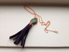 Leather Tassel Necklace- I have lots of leftover leather scraps that I could use for something like this!