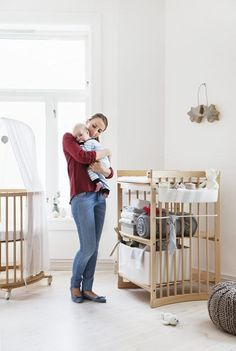 Scandinavian designed nursery in Natural wood – Stokke Mini Crib and Stokke Care Changing Table – Both innovative designs grow with your baby too!