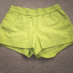 J Crew Lime Green shorts Size 2. Worn twice. HEM ON LEFT LEG IS OUT. can be easily sewn back together. Price firm J. Crew Shorts
