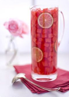 Tall pitchers make for a cool sangria look. Small chunks of watermelon and lime with a red or pink sangria. Party Drinks, Cocktail Drinks, Fun Drinks, Cocktail Recipes, Beverages, Sangria Recipes, Margarita Recipes, Drink Recipes, Refreshing Drinks