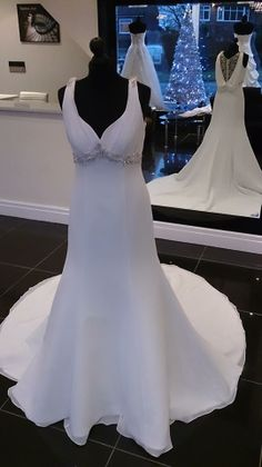 Beautiful Wedding Dress from Ellis Bridal Style: 11386 available from Timeless Bride Poynton. Detailed and lace insert back with a scoop. Detachable optional train. Crystal beaded under bust, sweetheart neck with shoulder straps.