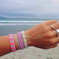 This @lalunarosedesign and 'Child of Wild' #flashtat arm party is where it's at.  Beach bling at its finest. We're obsessed!
