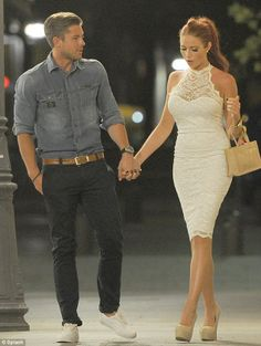 Night out: Amy changed into a chic white halterneck dress for their evening excursion