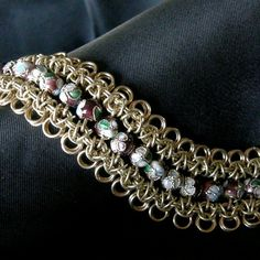 Here is a handmade, original design chain maille bracelet made by yours truly. The chain maille is crafted of jewelers brass & the beads are enameled cloisonne. The beads are not strung together, instead they are each individually woven into the actual chain maille. The bracelet is very fluid & flexible, it feels good against the skin, very smooth. It is medium weight & very durable. Each bracelet is handmade to order.  Bracelet is 7.5 inches in length.