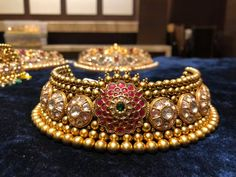 Gorgeous gold choker studded with rubeis and emeralds. Choker with south sea pearl hangings. Choker having gold ball hangings. Silver Jewellery Indian, Indian Wedding Jewelry, Bridal Jewelry, Gold Jewelry, Jewelery, Nice Jewelry, Antique Jewellery, Indian Bridal, Custom Jewelry