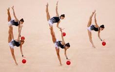 The Spanish team compete  in their group all-around rhythmic gymnastics qualification match
