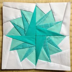 Pom Pom Paper Piecing Tutorial - Quilters on the lookout for a challenge and a unique star quilt pattern will adore this unique paper piecing pattern. This bright and beautiful Pom Pom Paper Piecing Tutorial shows you how to use paper piecing methods to create a quilt block pattern that resembles a pom pom or starburst.