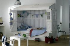 Close the doors, close your eyes. A children's bed in a wooden beach house.