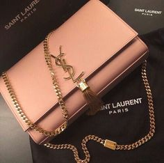 Elegant YSL bag in soft peach color with golden tassel details. #musthave #luxury #luxurylife #ysl #saintlaurent #yvessaintlaurent #fabfashionfix #baglover