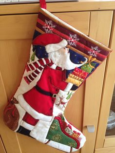 Christmas stocking. This was a bought stocking panel that I sewed with gold thread to outline the Santa. I love how it turned out.