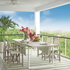Nestled on a hilltop with 180-degree views of Vieques Island, Puerto Rico, this two-story modern retreat boasts deep porches that are perfect for long meals al fresco.