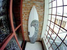A wave on a surfboard is like putting your father on your mother :) Here is how to paint your board http://360guide.info/surfing/surfboard-designs-and-art-ideas.html