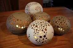 Pottery Orb Candle Holder...I wonder if this can be made out of plaster using a round form or balloon to make base. Then use straws or  circle cutters of different sizes for the holes. I'm also pinning this to hypertufa ideas...