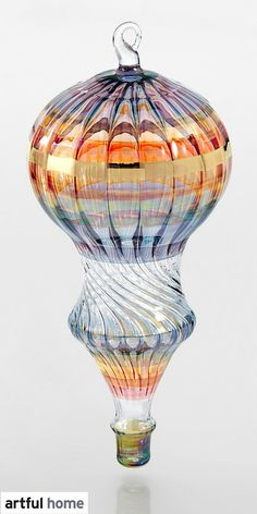 Hot air balloons inspire daydreams of adventure. The same is true of this miniature version rendered in blown glass by artist Bandhu Scott Dunham.