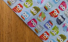Colourful Cute Owls on Light Blue Waterproof Vinyl Fabric